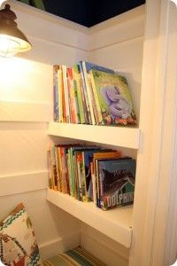 How to turn a closet into a kid's book nook - and now if I lived in a house with more than two closets we could do this - but I love the idea!!!