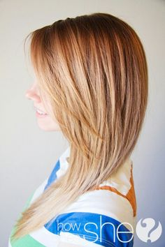 Long bangs. Love this cut. Layers are gradually longer along the side of her head.