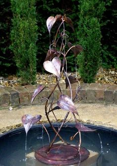 A small fountain based on the twining convolvulus vine plant