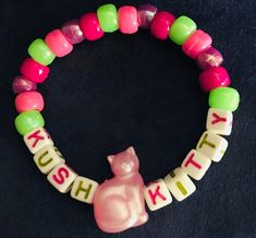 Pink and green kush kitty bracelet with pink pearlescent cat bead. Pony Bead Bracelets, Kandi Bracelets, Pony Beads, Good Vibes Festival, Rave Festival, Pony Bead Crafts, Rave Accessories, Rave Gear, Kandi Patterns