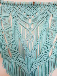 Gorgeous Wood macrame wall hanging boho This macrame wall hanging made from 5 mm natural cotton cord beautiful mint color. Wood is found in the beech forest of Germany. Size: Wood width - about 60 cm (23.6 ) Makramee height - approx. 102 cm (40 ) Total height (with cord for