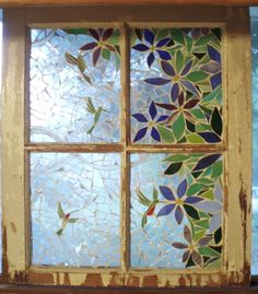 Window idea in stained glass. Do 3 panels, put hinges on and make fireplace screen!