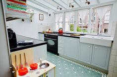 The kitchen looks out onto a darling backyard where the kids love to play!