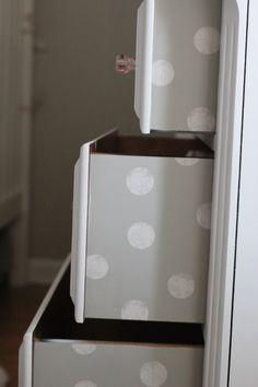 Love this DIY polka dot treatment on the drawers in this nursery - easy to do and what a fun surprise!