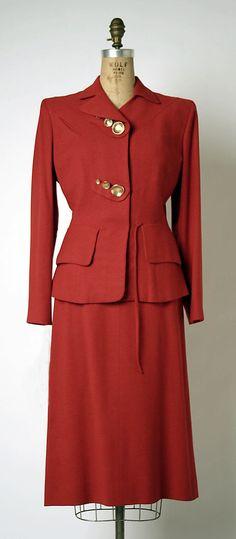 Suit  Gilbert Adrian  (American, 1903–1959)   Date:ca. 1950Culture:AmericanMedium:(a) wool, rayon, metal; (b) wool