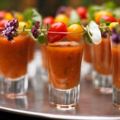 A great gazpacho can be both refreshing and savory at the same time. Taste test before the wedding with your caterer and see if you want a little spice or a milder flavor. Entice your guests with naturally colorful garnishes served in chilled shot glasses. You can include red and yellow tomatoes, zucchini strips, or vibrant edible flowers.  #weddingappetizers