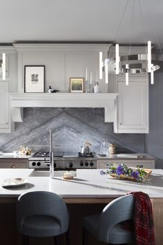 Blue de Savoie marble creates a statement backdrop for crisp, white quartz worktops and solid walnut cabinets #Smallbone