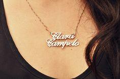 ClaraCampelo wears a name necklace.