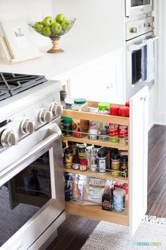 White kitchen cabinets with a pull-out spice rack! Kitchen Buffet, Kitchen Post, Kitchen Pulls, White Kitchen Cabinets, New Kitchen, Vintage Kitchen, Kitchen Ideas, Kitchen Appliances, Kitchen Reno