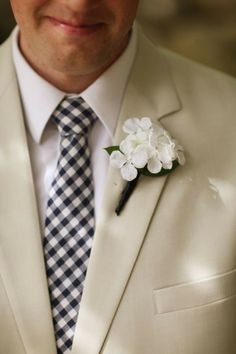 Summer wedding suit with pretty buttonhole flowers.  Gallery & Inspiration