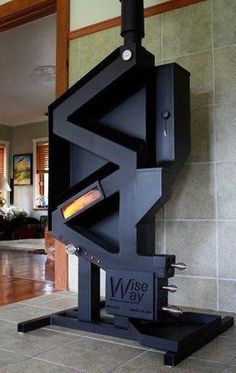 This is a rocket stove on steroids. A pellet stove that doesn't require electricity? You've found it, the WiseWay Pellet Stove. No noise, no moving parts, no electricity. Stove Fireplace, Rocket Stoves, Wood Burner, Homestead Survival, Deco Design, Home Projects, Building A House, Home Improvement, Cool Stuff