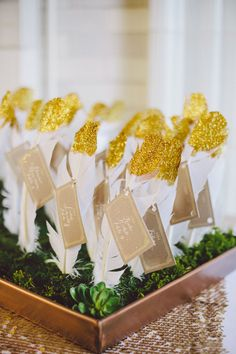 DIY Gold Glitter-Dipped Feather Escort Cards