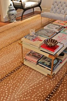 Details | Amy Berry  love the coffee table covered with STACKS of books! #RugsOnCarpet
