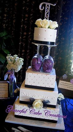 Elegant White Wedding Cake with Navy Blue and Lavender