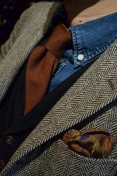 Love the denim work shirt with a tie and herringbone blazer