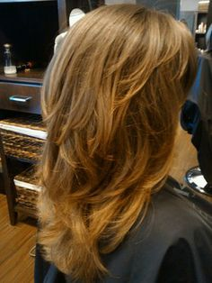Tons on layers to emphasize natural wave...Hair by Danielle E   Yelp