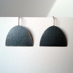 Large half oval oxidised earring | Contemporary Earrings by contemporary jewellery designer annabet wyndham