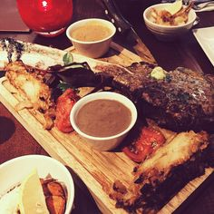 Birthday dinner at Miller & Carter. Me and @mbee123 had the tomahawk steak to share with chips. I had a porcini and black garlic sauce garlic mayo and Parmesan lettuce wedge and then grilled lobster tail scallop and prawns. SO GOOD.