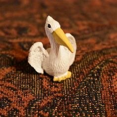 2017-01-23 I recently went to @michaelsstores to look at their #miniature stuff. I came back with several great things including this miniature #pelican! It's a bit too small to fit with my dollhouse as a full grown pelican but I've decided it's a juvenile pelican! #toy #MakeItWithMichaels