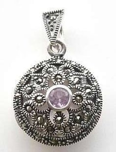 Marcasite and Amethyst Round Locket £40