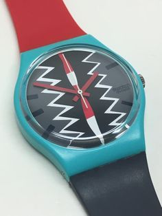 Vintage Swatch Watch 1986 Near Mint Condition Vintage Swatch Watch from 1986 is running and keeping perfect time with an included battery. Watch is in fantastic, near-mint condition. Original and unworn bands. Vintage Swatch Watch, Red And Grey, Vintage Watches, Cool Watches, Summer Collection, Two By Two, Fashion Accessories, Tonga, Man Shop
