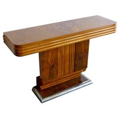 Art Deco console | From a unique collection of antique and modern console tables at https://www.1stdibs.com/furniture/tables/console-tables/