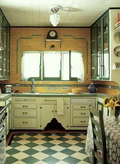 His mother's green checked floor inspired his own kitchen.