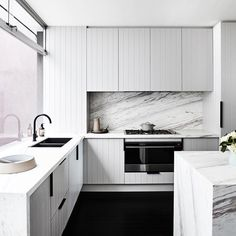 All white modern contemporary kitchen design with white cabinets, marble backsplash, waterfall countertops and black floors. Design by and Styling: Home Decor Kitchen, New Kitchen, Home Kitchens, Kitchen Mixer, Italian Kitchens, Kitchen Ideas, Modern Kitchen Design, Interior Design Kitchen, Kitchen Designs