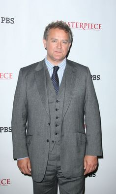 According to the show's writer Julian Fellowes, the parts played by Hugh Bonneville (Lord Grantham), Brendan Coyle (John Bates) and Maggie Smith (the Dowager Countess) were written for the actors that play them. Downton Abbey Season 3, Downton Abbey Cast, Brendan Coyle, Hugh Bonneville, Julian Fellowes, Dowager Countess, Maggie Smith, Movies And Tv Shows, Suit Jacket