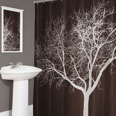 The one I found at Walmart is way cooler. It is white with a brown tree and AQUA birds!! Bathroom=Chocolate, aqua and white!