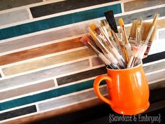 OMG! This couple PAINTS walls to look JUST like the backsplash tiles I dream of.  What a genius idea!  I am SO going to talk to our landlord about doing this!