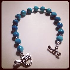 Spring 2013 Collection; Teal dragonfly bracelet made with teal stone beads, silver spacer beads and a silver dragonfly toggle clasp.  $24.99