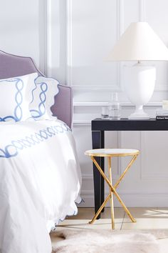 Black, gold, lavender and baby blue work in surprising harmony in this sleek and stylish bedroom look.