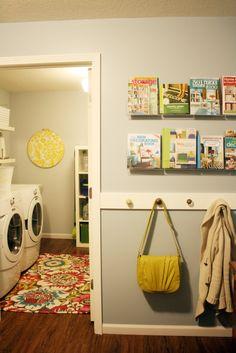 IHeart Organizing: Basement Progress: Studio Book Display. I love the rug!