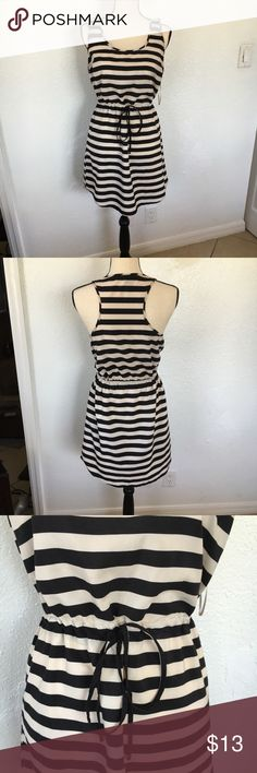 Striped summer dress Forever 21- Love 21 black and cream striped dress. Tie waist for flattering fit. Lightweight and perfect for a hot summer BBQ. In excellent condition with no signs of wear Forever 21 Dresses