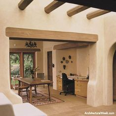 adobe style House - like the stucco walls, the vigas and exposed beams, the patio door from dining room, the office niche, the skylight