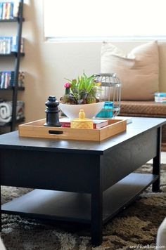 Style your coffee table with ease by adding fresh plants or flowers and Better Homes & Gardens accessories.