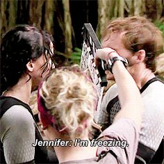 Behind the scenes of Catching Fire, after they got out of the water, Jen was freezing, so Sam rubbed her arms to try to warm her up, haha!