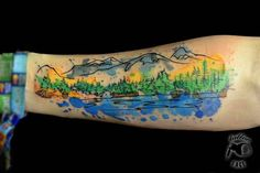 Watercolor Mountains With Trees Tattoo On Forearm