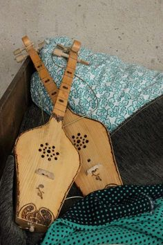 The panduri (Georgian: ფანდური) is a traditional Georgian three-string instrument common in the highland and lowland regions of Eastern Georgia. It is generally used to accompany solo heroic, comic and love songs, as well as dance.