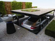 Como seria sua casa no futuro? | A garagem da casa, por sua vez, além de high-tech, seria estreita o suficiente para não ocupar espaço e comportar mais de um carro.