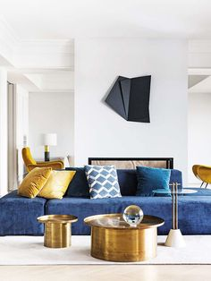 Glamorous blue and gold modern living room in Madrid on Thou Swell @thouswellblog