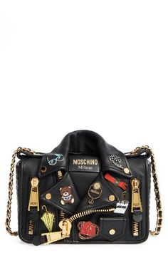 Free shipping and returns on Moschino Biker Jacket Shoulder Bag at Nordstrom.com. The Moschino Motorcycle Jacket Bag—updated with playful pin accents and golden hardware—keeps up with the brand's new creative direction with its playful sense of humor and edgy literal interpretation of classic biker style. The pull-through chain-and-leather strap adjusts from double-handle to crossbody length for versatile styling options.