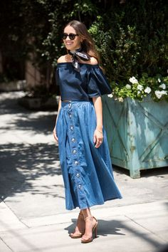 Style your denim midi skirt with an off-the-shoulder top and a neck scarf for added volume.