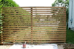 Modern Wood Slatted Outdoor Privacy Screen: Details On How To Build - - Last summer I shared our modern wood slatted outdoor privacy screen. I have had so many questions about it, that I thought it was time to share details. Backyard Privacy Screen, Privacy Screen Outdoor, Privacy Walls, Deck Privacy Screens, Privacy Wall On Deck, Diy Patio, Backyard Patio, Backyard Landscaping, Patio Decks