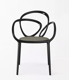 Today's crush: the assymetrical Loop chair by Swedish studio Front for Qeeboo, a new Italian brand presenting their first collection at the. Chair Design, Furniture Design, Furniture Chairs, Fine Furniture, Unique Furniture, Ergonomic Computer Chair, Futuristic Home, Camping Chairs, Art Furniture
