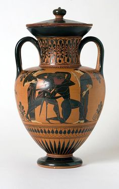 Black-Figure Amphora with Scenes of Apollo Entertaining Dionysus and Hermes, and Theseus Killing the Minotaur, 530-520 B.C. Terracotta 2003.18a-b  A vase-shaped container with two handles and along neck, the amphora was used by the ancient Greeks  to transport and store a variety of commodities, from wine and olive oil to grain and fish. This richly decorated amphora is painted in the black-figure style and features an assembly of the ancient Greek gods