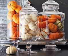 Creating a festive display can be as simple as tossing a few pumpkins (faux or otherwise!) into an apothecary jar. Variations on this theme are bountiful—try the look with pomegranates, pears, or even pinecones.