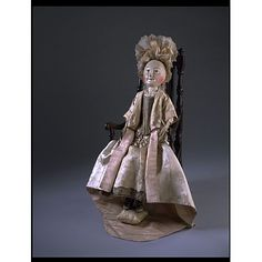 Lady Clapham offers a fine example of both formal and informal dress for a wealthy woman in the 1690s (Museum # T.846 to Y-1974). Her formal outfit includes a mantua (gown) & petticoat, while her informal dress is represented by the nightgown (a dressing gown rather than a garment worn to bed) and petticoat. Accessories such as the stockings, cap and chemise (a body garment) are very valuable since very few items from such an early period survive. V T.846B-1974
