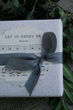 Sheet music as gift wrapping. With brown kraft paper at Christmastime -- love this idea!